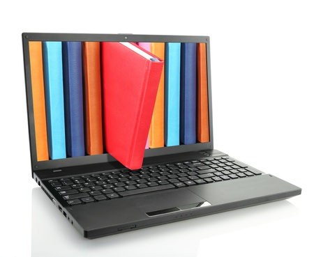 Laptop computer with colored books  photo