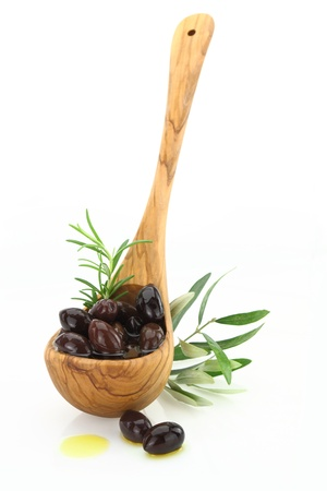 kalamata: Olives in a wooden spoon on white background  Stock Photo