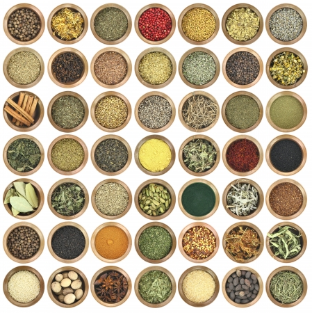 Large collection of metal bowls full of herbs and spices photo