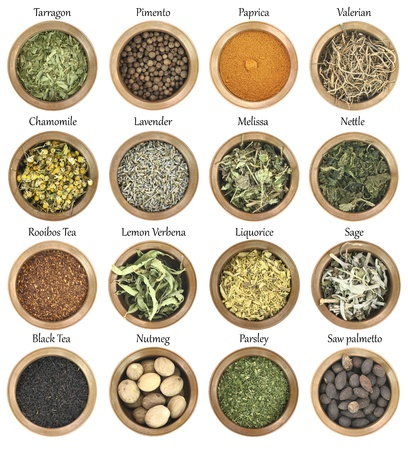 dried spice: Collection of metal bowls full of herbs and spices Stock Photo