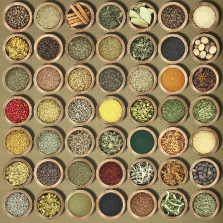 Large collection of metal bowls full of herbs and spices Stock Photo