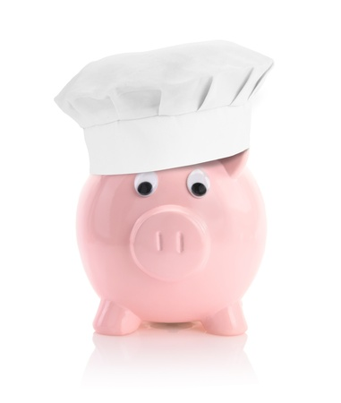 low prices: Cooking economy represented by a piggy bank with a chef hat Stock Photo