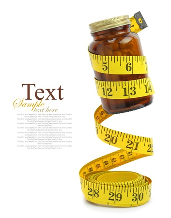 drug control: Measuring tape with a bottle of diet pills