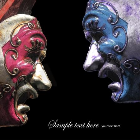 Vintage tragedy theater masks on black background photo