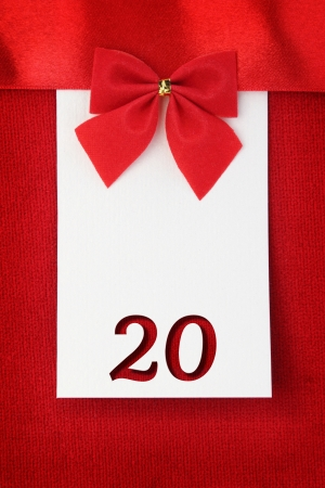 20th: Number twenty on red greeting card