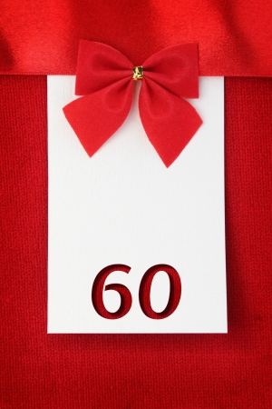 60 years: Number sixty on red greeting card Stock Photo