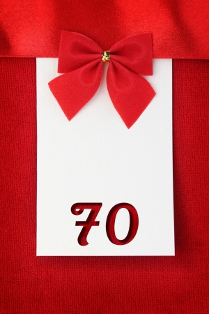 Number seventy on red greeting card photo