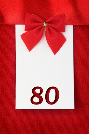 80 years: Number eighty on red greeting card Stock Photo