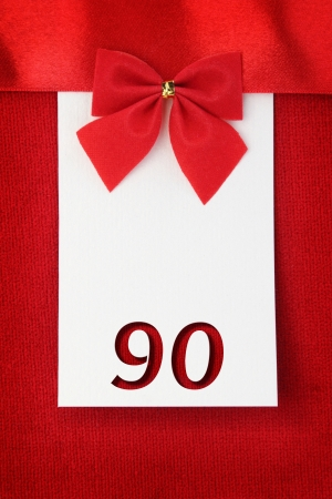 90: Number ninety on red greeting card