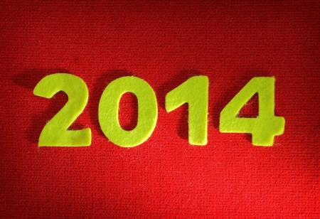 2014 new year on red wool background photo