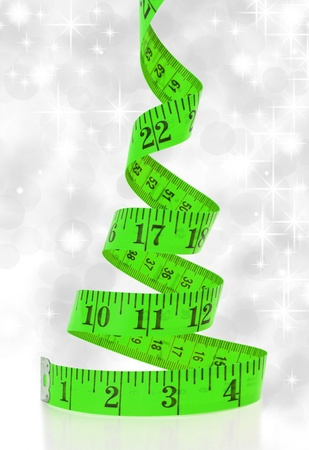 made to measure: Christmas diet concept. Christmas tree made from measure tape