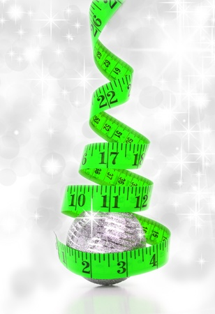 Christmas diet concept represented by a Christmas tree made from a measure tape