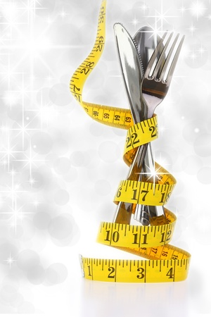 represented: Christmas diet concept represented by a cutlery set with measuring tape