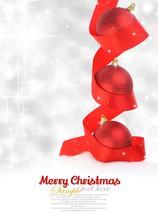 Red Christmas balls with ribbon on snowy background Stock Photo