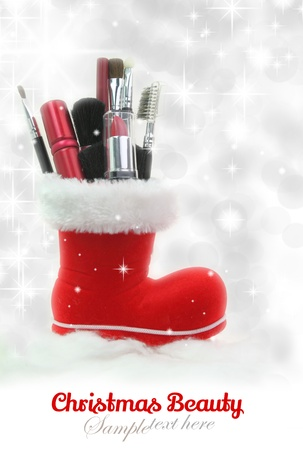 Santa Claus boot stuffed with woman cosmetics photo