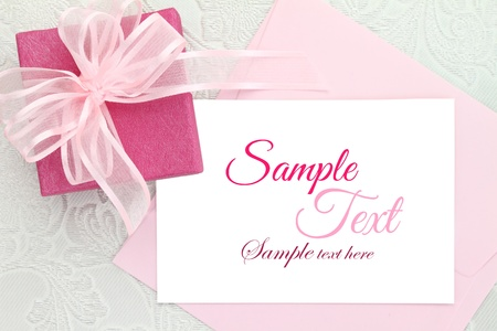 baptism: Gift box with ribbon and white invitation card