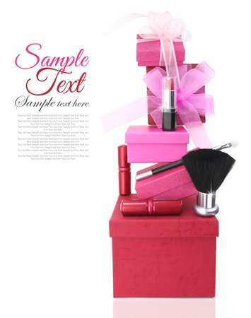 Gift boxes and woman cosmetics photo