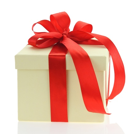 ecru: Ecru gift box with red ribbon isolated on white background