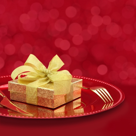 Festive table setting with gift box on a plate Stock Photo - 22022255