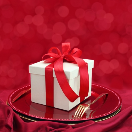 Festive table setting with gift box on a plate  photo