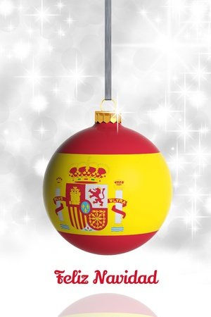 spanish language: Merry Christmas from Spain. Christmas ball with flag