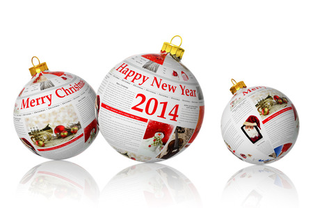 Newspaper Christmas balls on white background photo