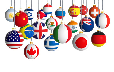 Christmas balls with different flags hanging on white background photo