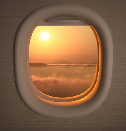 a window on the world: Airplanes window seat view with sunsetsunrise Stock Photo