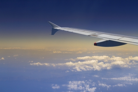 troposphere: Aerial shot from airplane with wing visible Stock Photo
