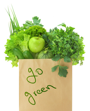 go green: Fresh green vegetables and fruits in a paper grocery bag Stock Photo