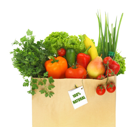 Paper bag full with fruits and vegetables  photo