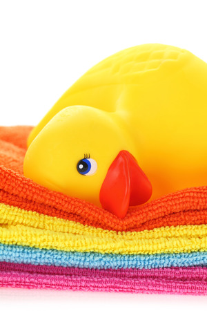 Rubber yellow duck with towels photo