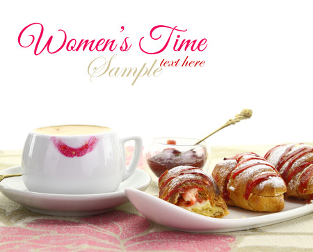 chit chat: Cup of coffee with lipstick mark and croissant with strawberry jam
