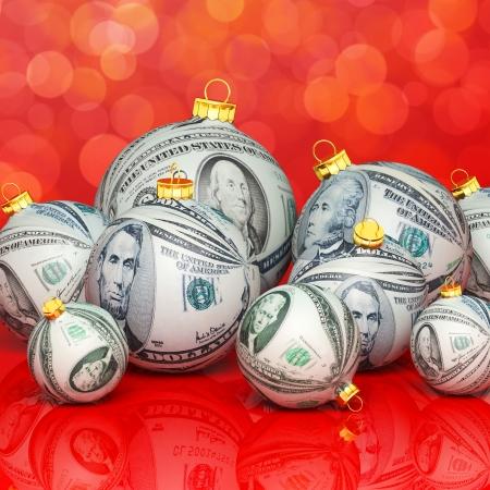 holiday profits: Christmas balls with money texture Stock Photo