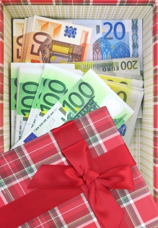 Present box with money inside photo