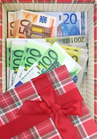 Present box with money inside Stock Photo - 23517762