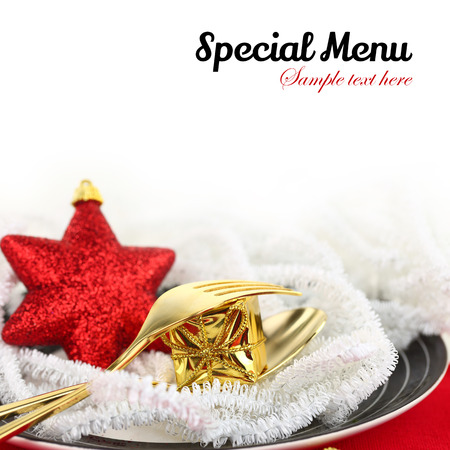christmas menu: Christmas table setting with ornaments on a plate