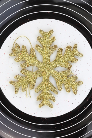 Christmas golden snowflake on a plate photo
