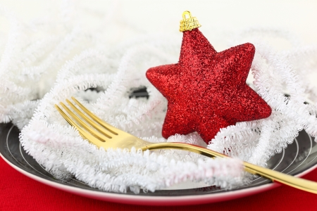 Christmas table setting with ornaments on a plate photo