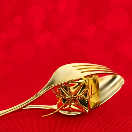 Christmas golden cutlery with ornament on red background Stock Photo - 23799491