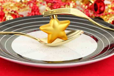 Christmas table setting with ornament on a plate photo