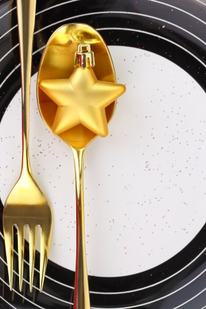 Christmas golden cutlery on a plate photo