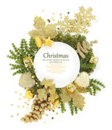 White plate with Christmas ornaments around it photo