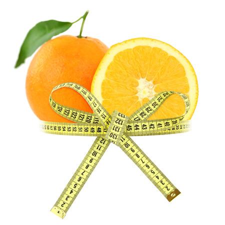 cintas metricas: Naranja con cinta métrica, el concepto de dieta