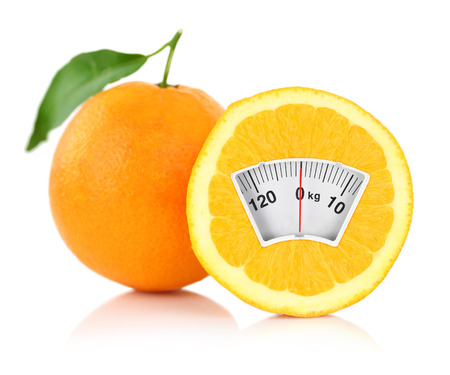 diet concept: Weight scale on an orange, diet concept  Stock Photo