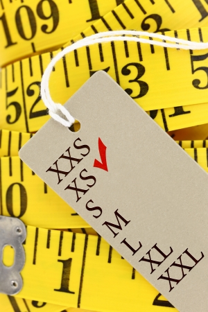 s m: Measuring tape closeup with xs size tag Stock Photo