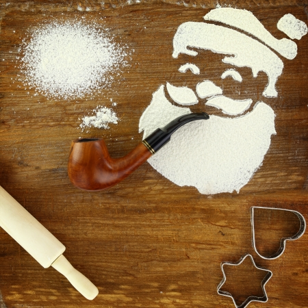 Santa Claus made of flour smoking pipe photo