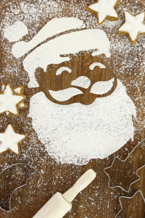 Concept for baking with Santa Claus and snow made of flour photo