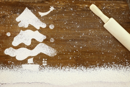 Concept for baking with snowy Christmas tree made of flour photo