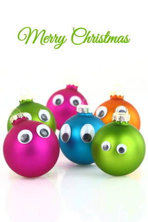 Colorful cute Christmas balls with eyes isolated on white photo